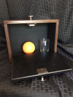 The Ghost Cabinet Open To Display Ball And Glass