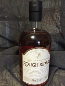 A bottle of Rough Rider Bourbon, batch #4 (see bottom right corner of the label)