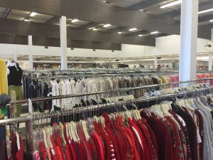 Notice the womenswear is organized by color.  Also notice the volume of clothing in the store.
