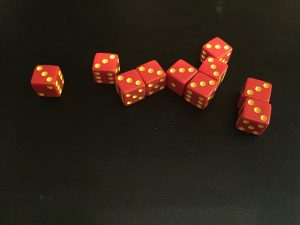 "Winning the basic game of Tenzi requires rolling all ten dice to show the same number. In this photo, the winner's dice all showed ""three""."