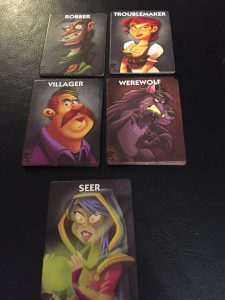 In the basic game, character cards in play are the werewolf, villagers, a seer, a troublemaker, and a robber.